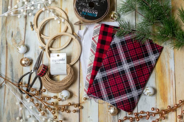 DIY Heirloom Christmas Ornament guest post by Coral + Co by popular Utah quilting blog, Diary of a Quilter: image of embroidery hoops, fabric scissors, plaid flannel fabric, twine, and plaid tape.