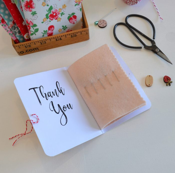 Fabric Covered Needle Cards - guest post by Sedef Imer by popular quilting blog, Diary of a Quilter: image of an opened fabric covered needle cards book.