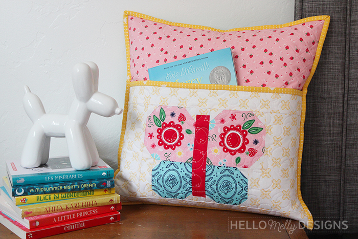 Quilted Butterfly Reading Pillow by Guest Host Melanie Collette by popular quilting blog, Diary of a Quilter: image of quilted butterfly reading pillow.