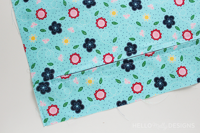 Quilted Butterfly Reading Pillow by Guest Host Melanie Collette by popular quilting blog, Diary of a Quilter: image of blue floral fabric.
