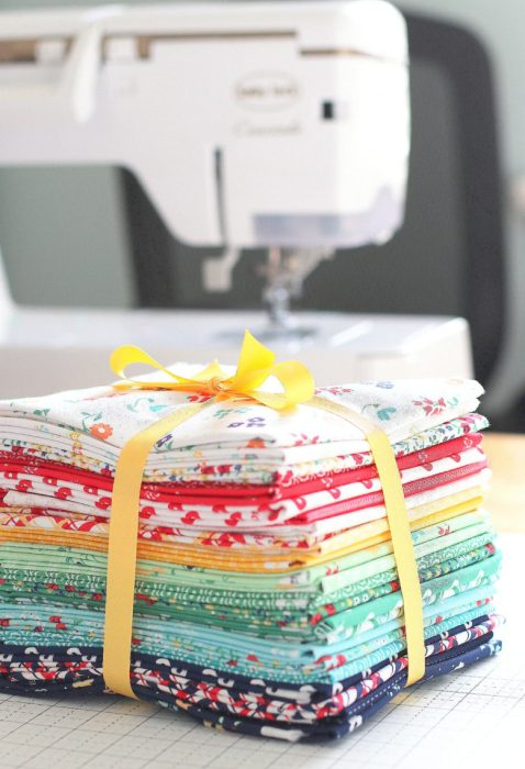 Sugarhouse Park fabric collection by Amy Smart for Riley Blake Designs | Delayed Pine Hollow Pattern by popular quilting blog, Diary of a Quilter: image of a Sugarhouse Park fabric bundle.