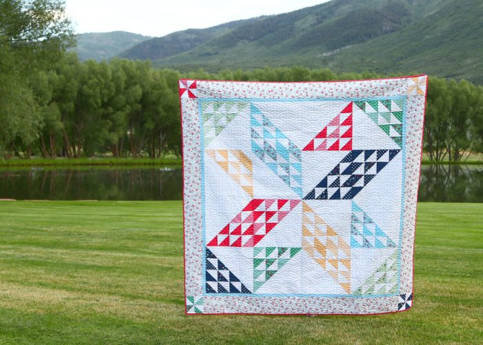 Brand new quilt pattern: Sugarhouse Star by popular Utah quilting blog, Diary of a quilter: image of a star quilt being help up outside by someone
