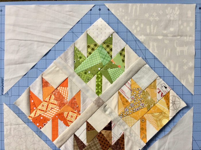 Scrappy Maple Leaf Quilt Pattern Tutorial by guest writer Leila Gardunia by popular quilting blog, Diary of a Quilter: image of scrappy maple leaf quilt.