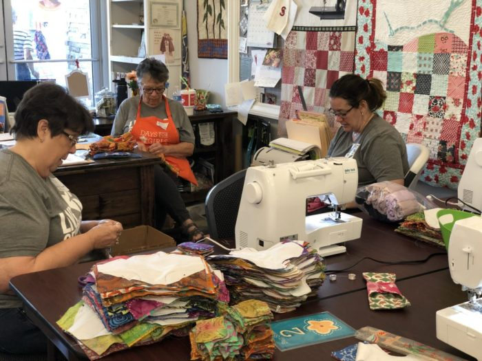 Days For Girls by popular quilting blog, Diary of a Quilter: image of women sewing menstrual cycle kits.