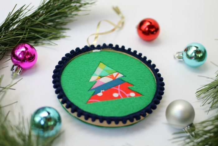 Felt Tree Ornament Tutorial by guest Stephanie of Swoodson Says by popular quilting blog, Diary of a Quilter: image of a felt tree ornament, some pine tree boughs, and small ball Christmas ornaments.