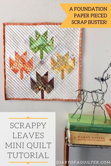 Scrappy Maple Leaf Quilt Pattern Tutorial by guest writer Leila Gardunia by popular quilting blog, Diary of a Quilter: image of scrappy maple leaf quilt hanging on a wall.