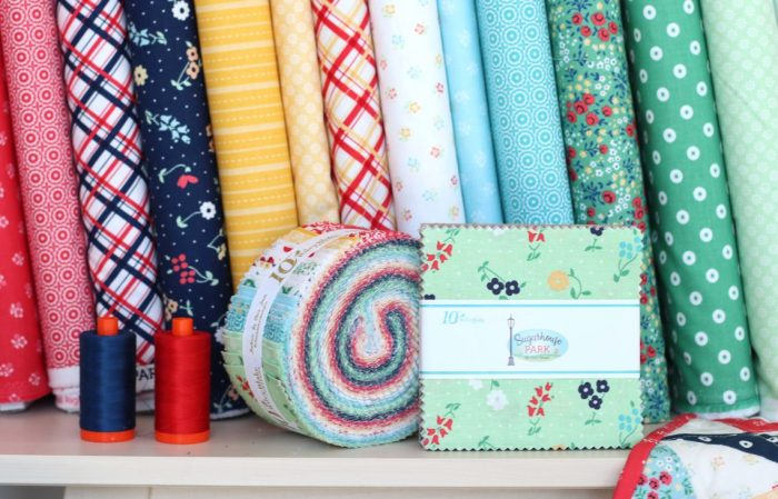 Sugarhouse Park Fabric Collection by Amy Smart by popular Utah quilting blog, Diary of a Quilter: image of Sugarhouse Park fabric bolts, fat quarter bundles, and jelly rolls.