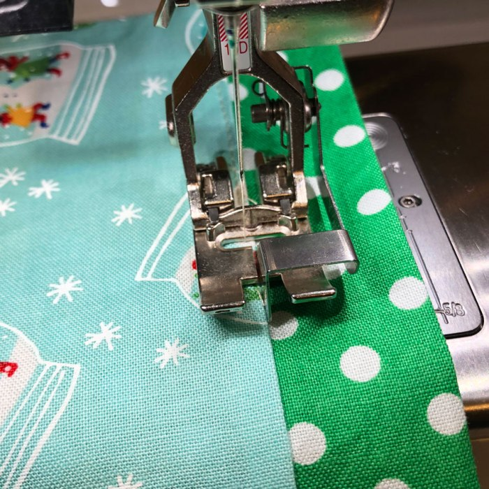 Perfect Size Custom Gift Bags Tutorial by May Chappell by popular Utah sewing blog, Diary of a Quilter: image of a custom gift bag in a sewing machine.