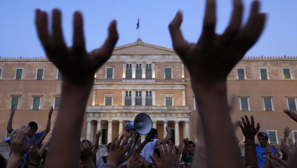 Après huit années d'austérité, la Grèce sauvée mais endettée et appauvrie