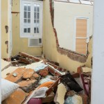 The family left to take shelter before the wall and roof crashed into their bedroom, saving their lives.