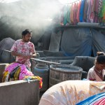 Man sorting clothes.  Dhobi Ghat, world's largest outdoor laundry, Mumbai
