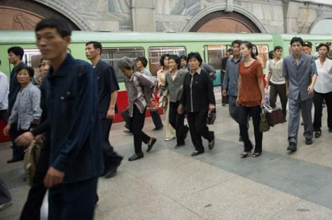 Buhong station.  commutesr getting off.  Metro riders XX00,000 d