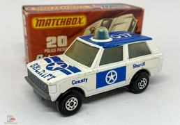 "Matchbox Superfast No.20b Range Rover Police Patrol - white body with blue Sheriff tampo print, ""County Sheriff"" side labels, clear frosted windows, blue spinner and roof light, bare metal base, Maltese Cross wheels - Good Plus in Excellent type J box."