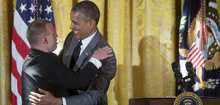 Tim Harris gives one of his famous hugs President Obama