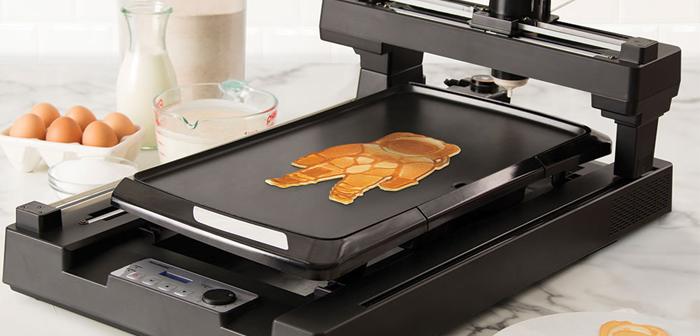 Si la création de l'art à l'aide alimentaire imprimantes 3D crêpes était déjà une possibilité, Pourquoi ne pas automatiser l'art de café au lait?