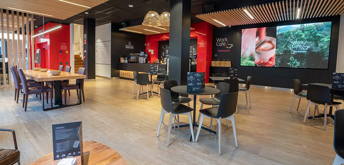 As one of the best examples that combines these aspects are the Santander Work Coffee, places that combines a concept of working with a service based on hospitality through a coworking space and a café, that break with the classic vision of the office of the Banco de Santander or any other entity.
