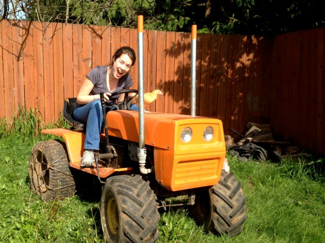 Me on the orange mower with our free Craigslist cockerel, Bucky.