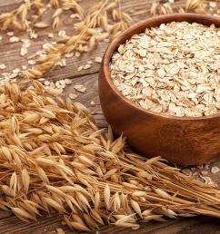 oat flakes rolled oats in wooden bowl in front of oat ears  [ 1400 x 840 Pixel ]