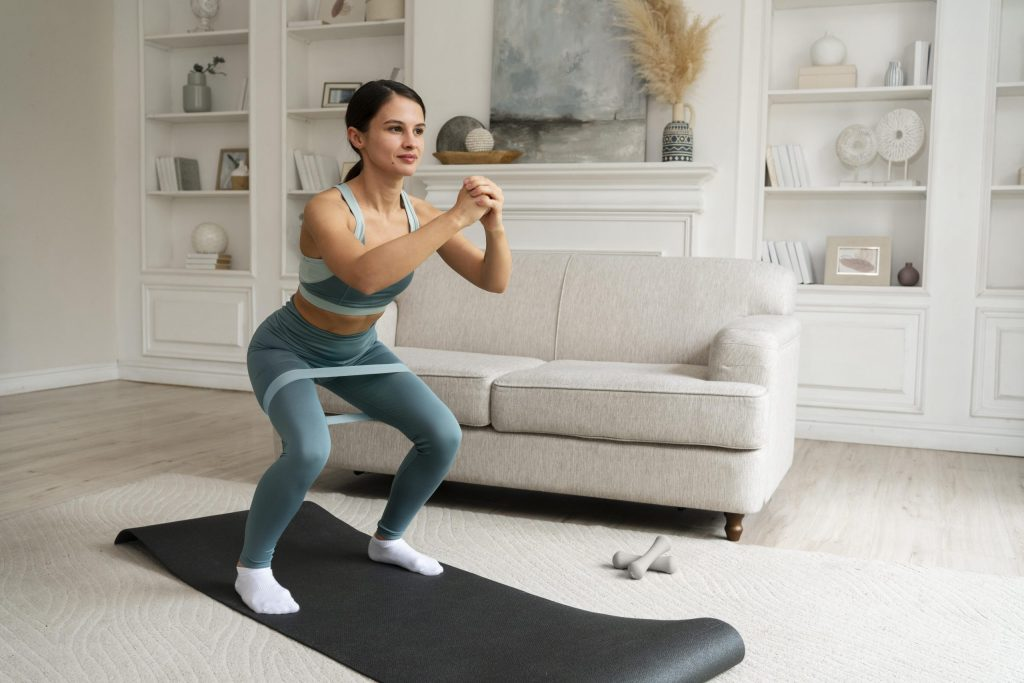 woman-doing-her-workout-home-fitness-mat