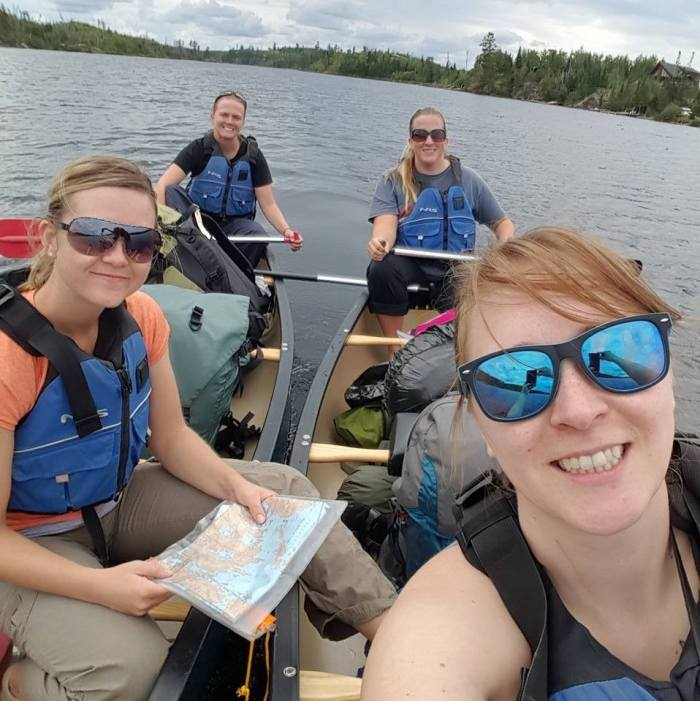 The Four Amigas - Unscathed and full of energy in our canoes! (Clockwise from bottom left: Terrie, Sandy (sister), Me, and Nicole)