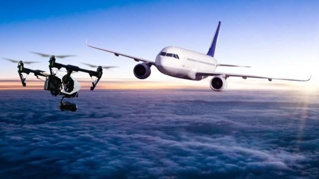 drone flying near airplane