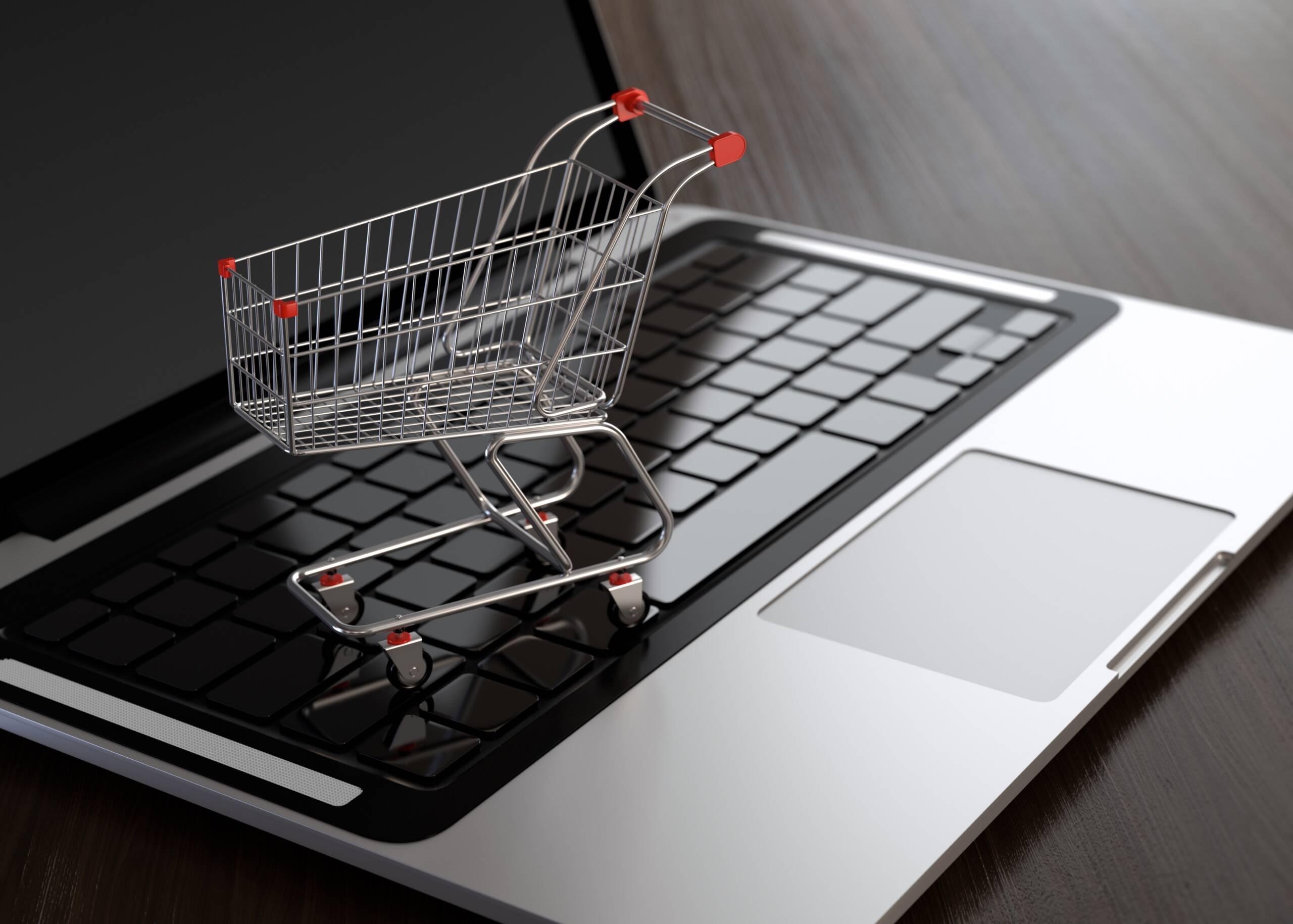 Laptop with shopping cart Singapore e-commerce platform
