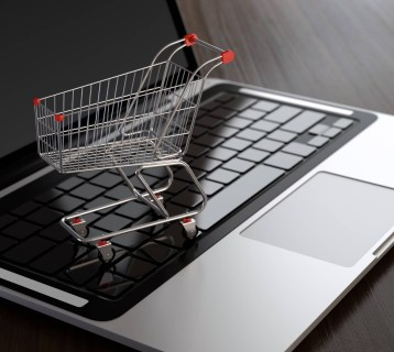 Laptop with shopping cart Singapore e-commerce platform