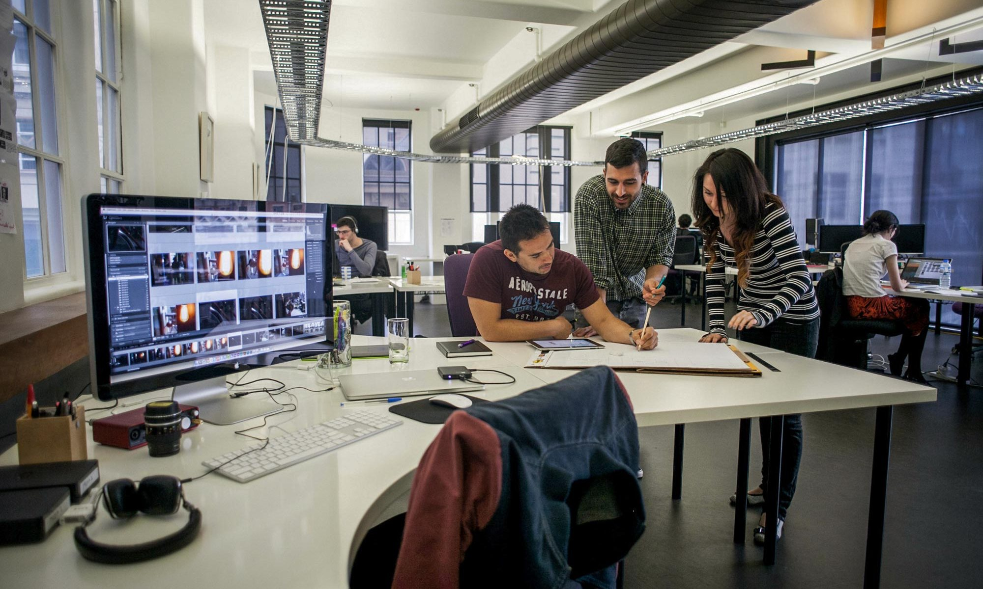 A team of professionals discussing design of a website