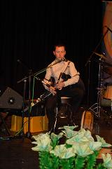 Darragh on stage playing the Uilleann pipes.