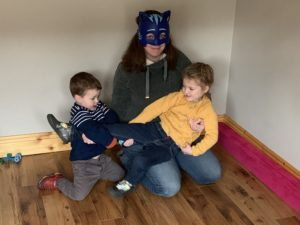 Emma my wife wearing a cat mask playing with my son and daughter
