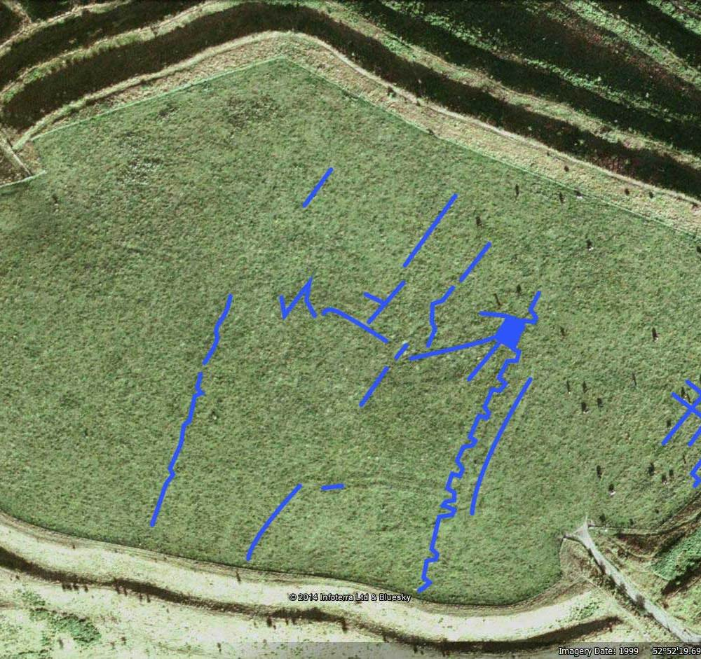 Old Oswestry hillfort - WWI trench lines in blue (partial and approximate). Image © Google/Getmapping.