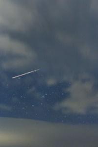 Night sky with plane