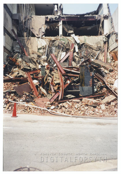 Demolition of a Liberty Street building, seen from the back on N. Main Street, for the One West Fourth building, 2000.