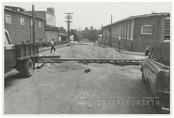 Repairing the bumps around the railroad tracks on South Marshall Street, 1967.