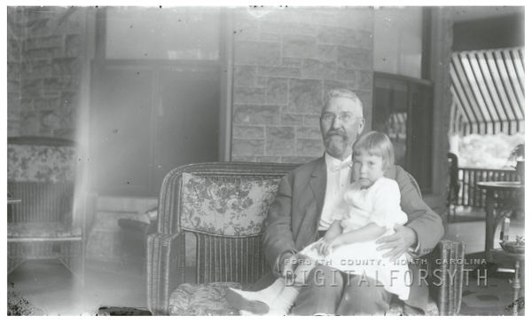 R. J. Reynolds holding his daughter, Mary.