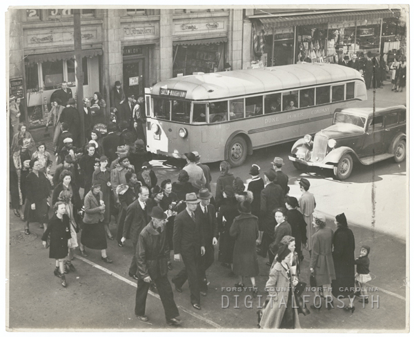 People crossing Liberty Street at Fourth Street, 1939.