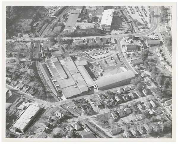 Aerial showing Hanes Dye and Finishing Company, 1954. Some of the surrounding streets are Northwest Boulevard, Buxton Street, N. Cherry Street and Chatham Road.