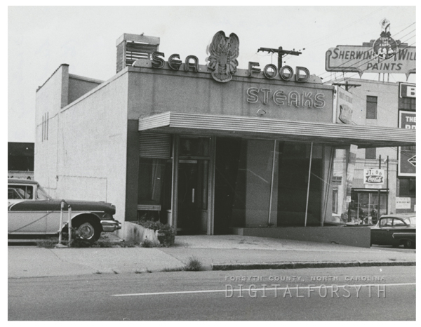 Former restaurant building at corner of W. Fifth and N. Cherry Street, 1962.