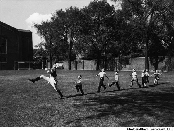 Children follow the Drum Major at the University of Michigan, 1950.