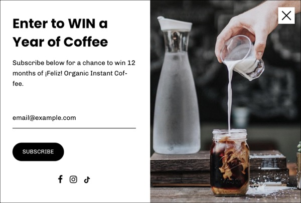 an email sign up win a year of coffee with a picture of someone pouring milk into a mason jar of coffee