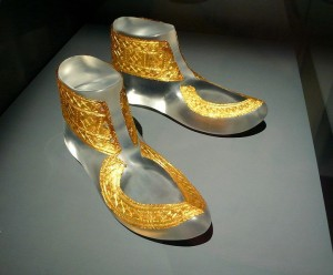 Image of fine gold decorative coverings for a pair of shoes or boots