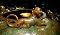 Top of the Hochdorf prince's bronze cauldron showing an ornamental lions