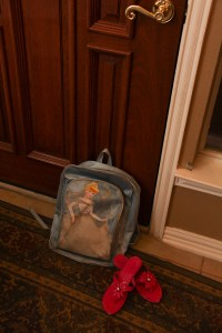 shoes and backpack are at the front door