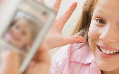 4 Cell Phone Etiquette Tips To Teach Your Kids Before Giving Them a Phone