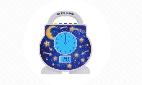 Toddler Alarm Clock features clock face with stars and space scene used for sleep training