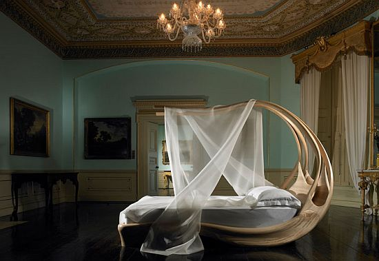 A Bedroom With An Extravagant Canopy Bed (via <a rel=