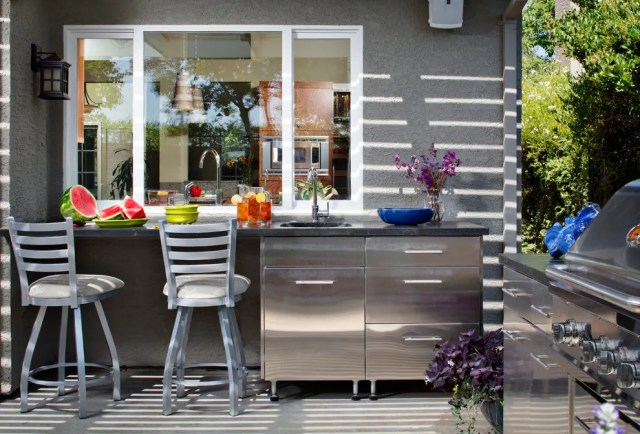 A prep area that connects two kitchens through a window is a very smart design decision.