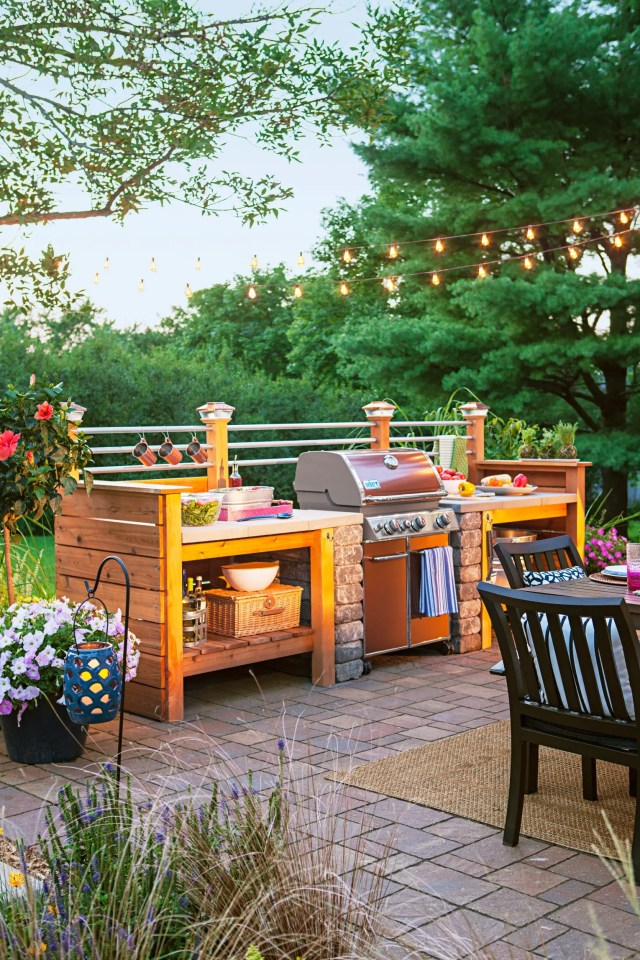 Weber gas grills surrounded by DIY cedar storage units is a quite popular way to go nowadays.
