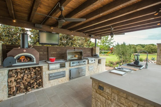 Wood burning pizza oven could help you to feed everybody during long summer parties.