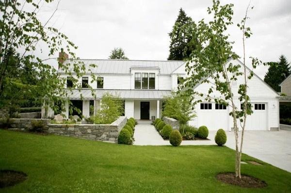 crisp white farmhouse surrounded